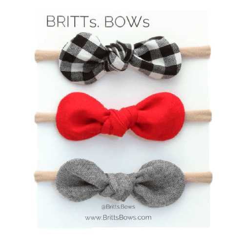 Set of three baby bow headbands in red, black plaid, and grey.