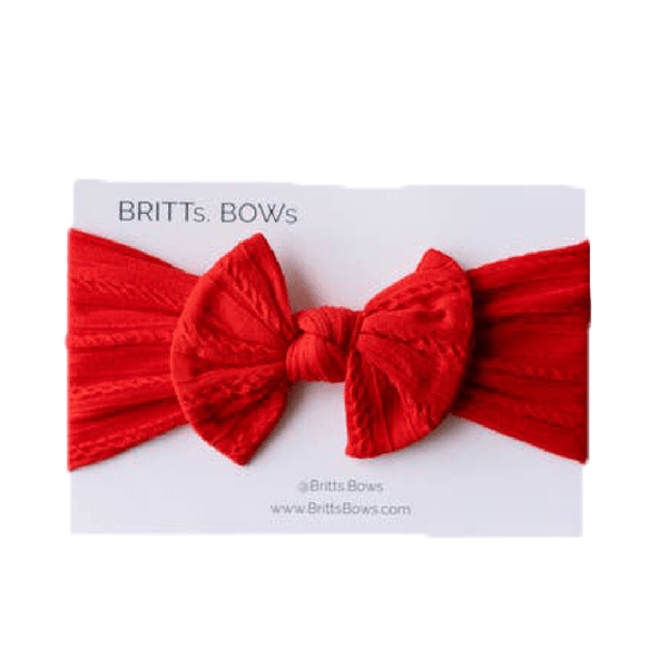 Red cable knit baby bow headband with a knotted bow.