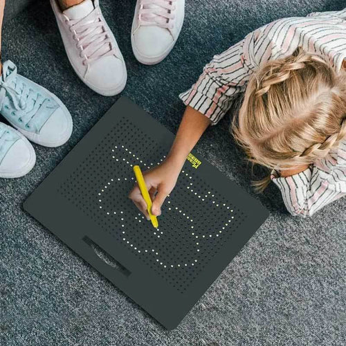 Girl with black magnetic tile drawing tablet