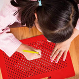 Child with red magnetic drawing board tablet for kids
