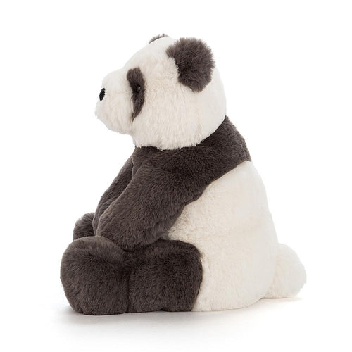 Side view of black and white stuffed panda by Jellycat