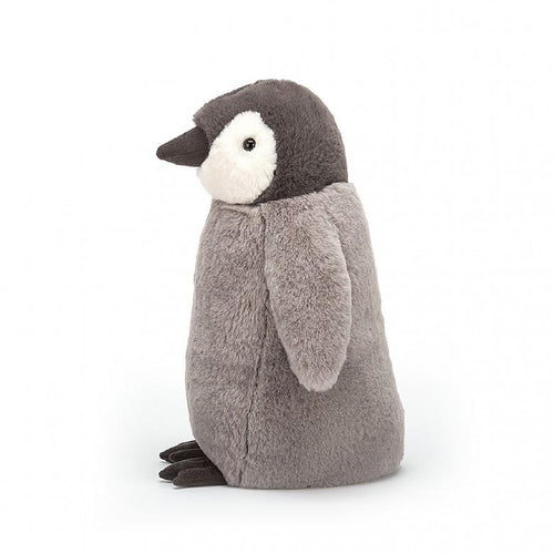 Side view of stuffed grey penguin by Jellycat