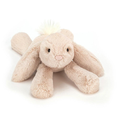 Laying down stuffed rabbit by Jellycat