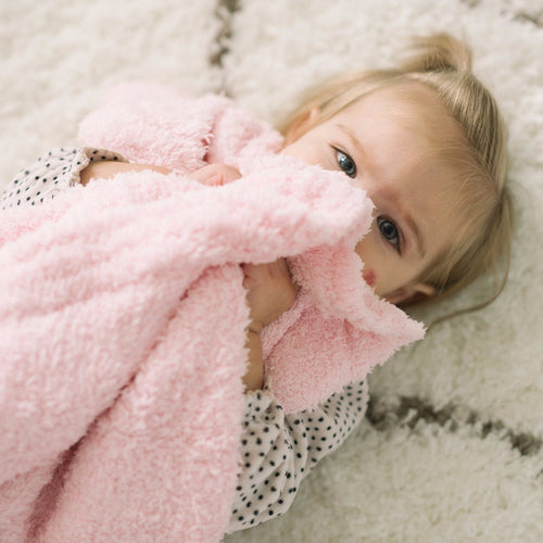 Baby with pink fluffy blanket