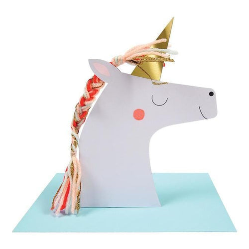 Three dimensional unicorn stands up from a card.
