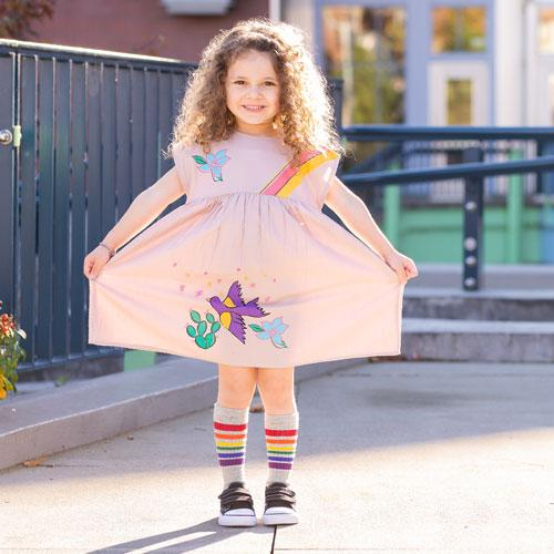 Pink short sleeve dress for girls with bird and rainbow graphics