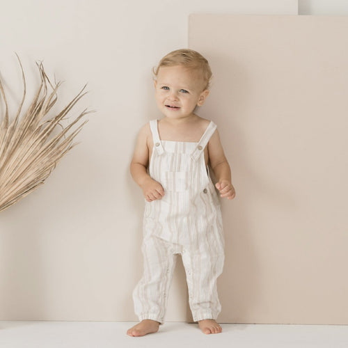 Baby striped natural overalls on model