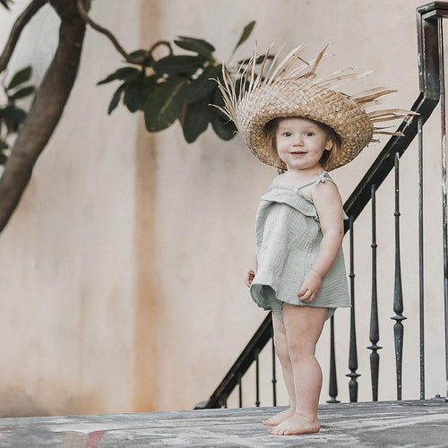 Pale green bloomers on toddler girl model