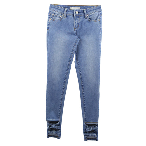 Girls skinny medium wash jeans with cutout bows at ankles