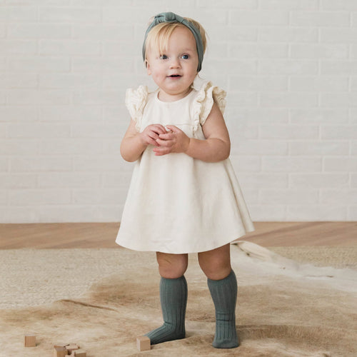 Ivory organic knit ruffle dress for baby girl
