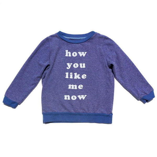 "Blue kids sweatshirt with ""like me now"" white lettering"