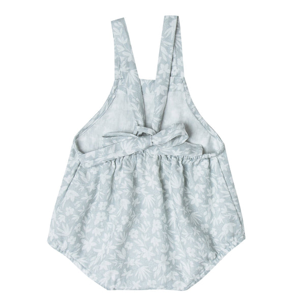 Light blue ditsy print romper with tie back for baby girl