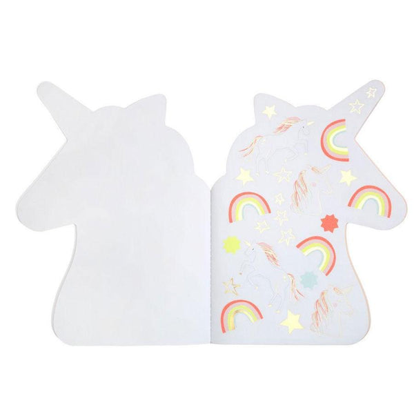 Rainbow stickers in a unicorn sketch book