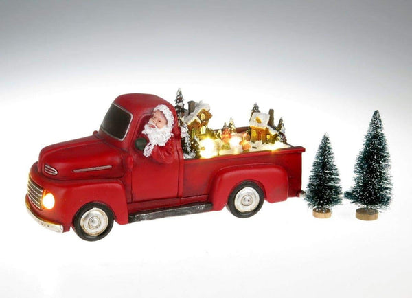 Lightahead Musical Santa Driving Pickup Truck Figurine with Christmas Scene, Turning Skaters, LED lights and 8 Melodies