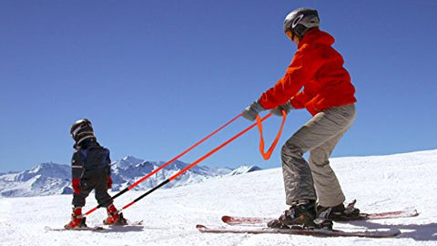 A kids ski harness in use