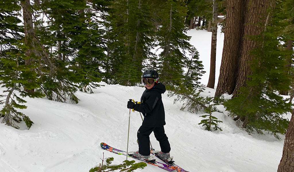 Kid skiing in the trees