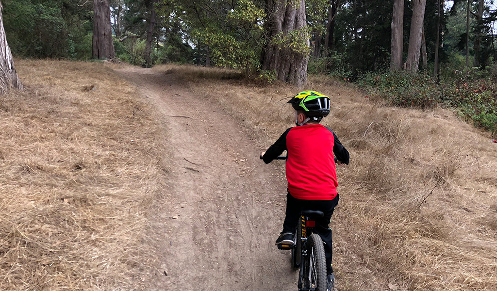 Boy on bike in Golden Gate Park