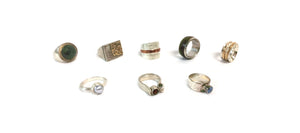 a selection of eight silver rings, accented with gemstones, gold, wood and pearls