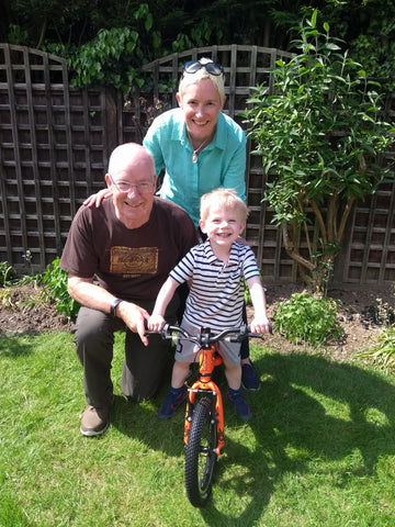 Child on bike with grandparents