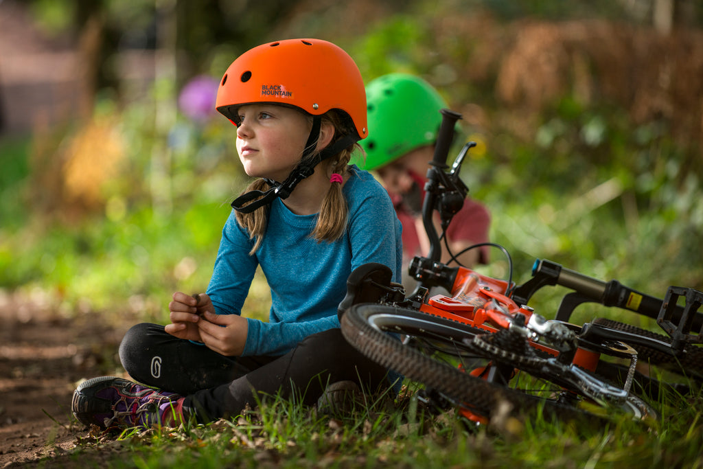 Girl sitting wearing Black Mountain helmet