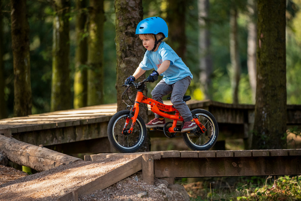 Child on mountain bike course