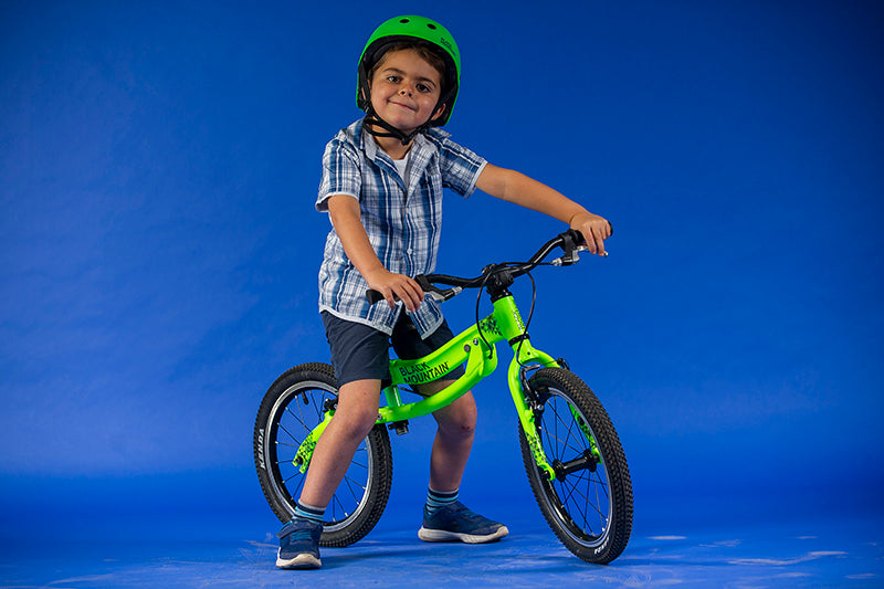 5 year old boy on a balance bike
