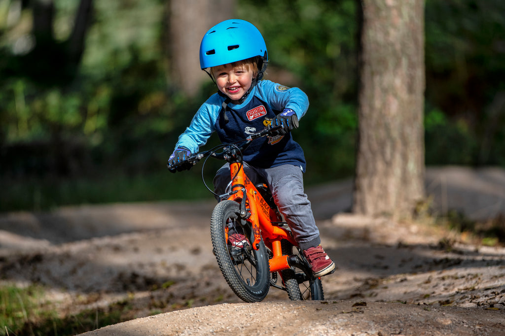 Boy riding trails on lightweight kids bike