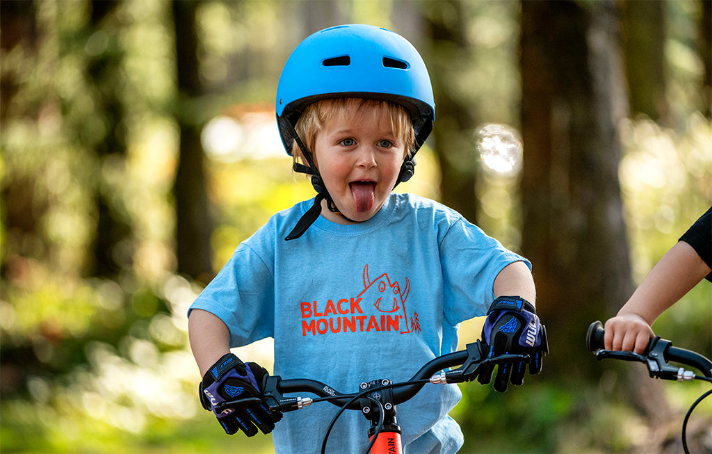 Boy on kids bike in blue t shirt