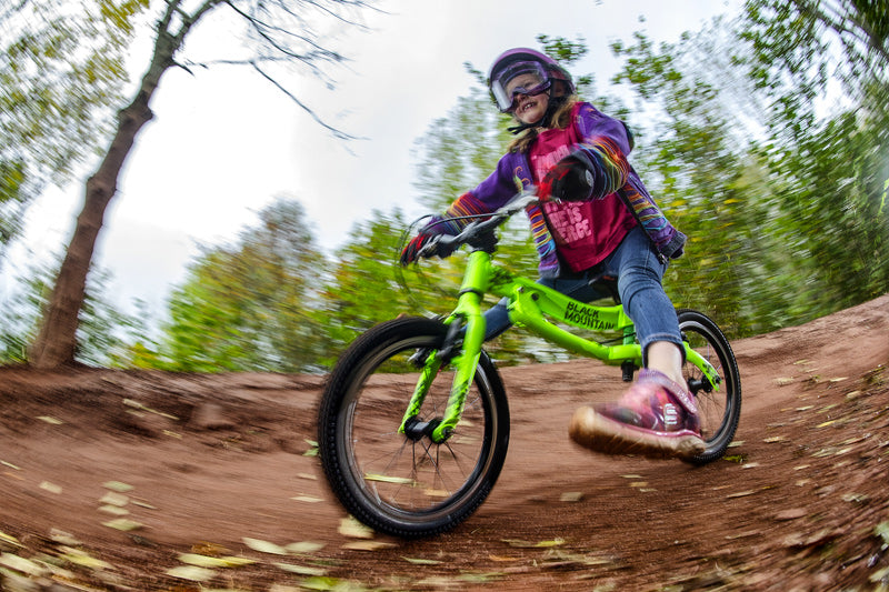 Girl balance biking off-road