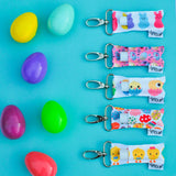 A Collection of Easter themed LippyClips on a blue background with colorful plastic eggs.