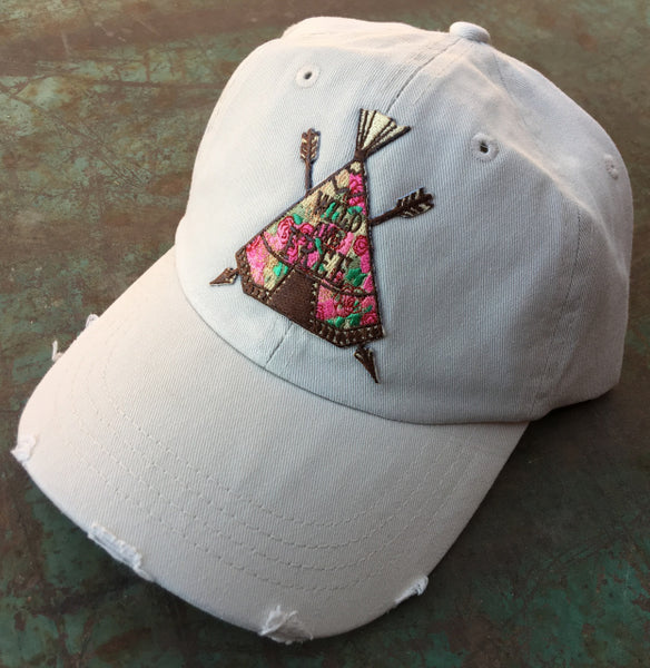 teepee on tan baseball cap