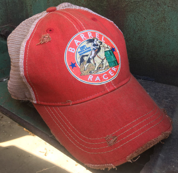 red cap with a barrel racer patch on it