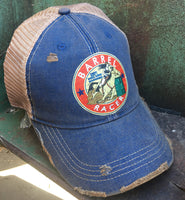 blue cap with a barrel racer patch on it