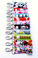 A collection of a dozen LippyClips representing a variety of sports and hobbies.