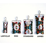 LippyClip and three SaniClip sizes holding different hand sanitizers. Mini, standard, and jumbo.