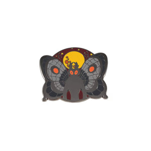 image of an enamel pin with the mothman on it