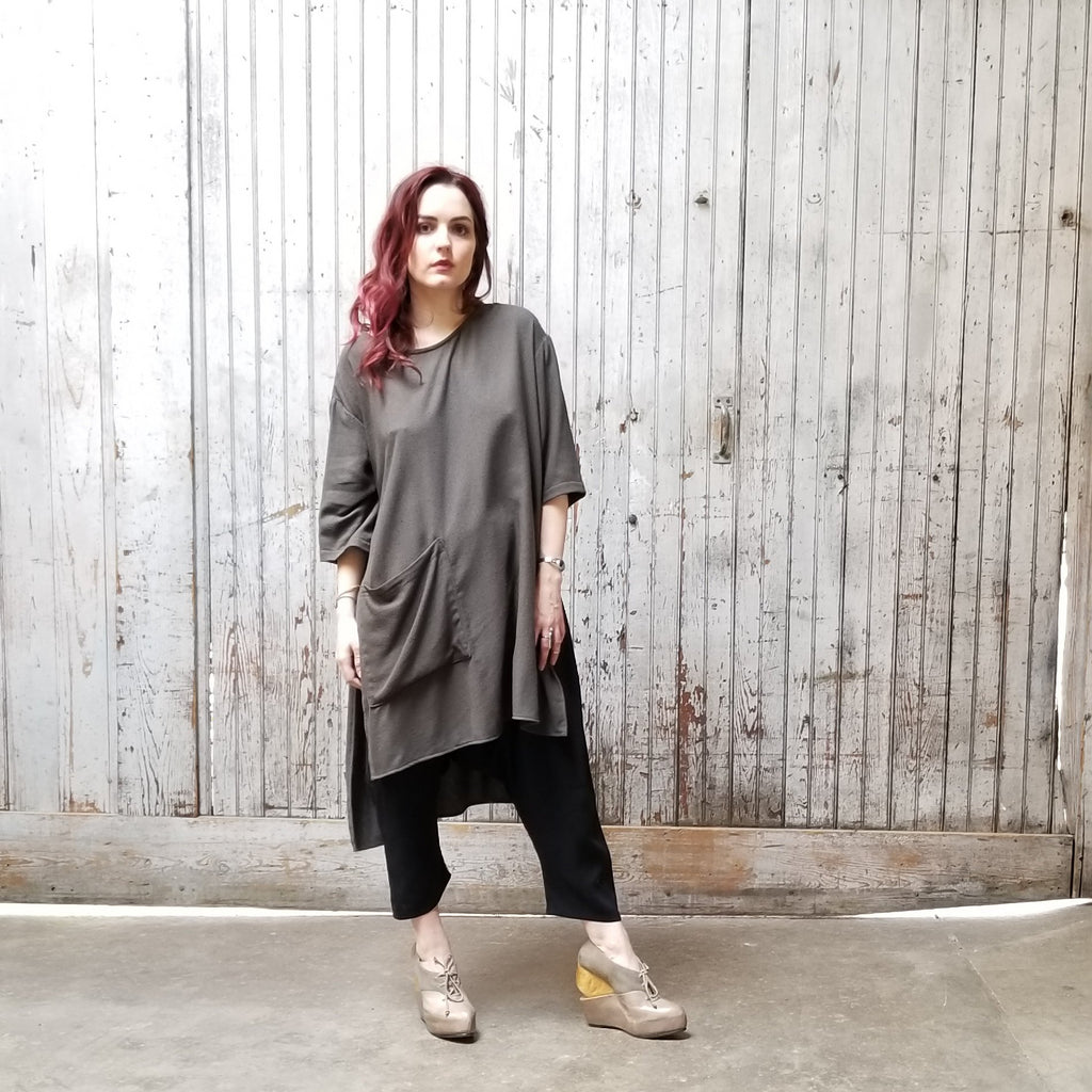 Black Hi Low Pocket Tunic with an asymmetrical square front pocket.