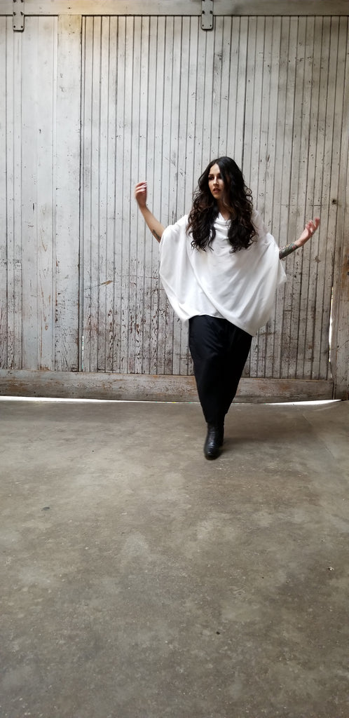 White LaRue Oversized Tunic with a cowl neckline.