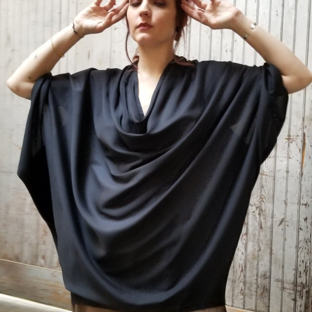 Black LaRue Oversized Tunic with a cowl neckline.