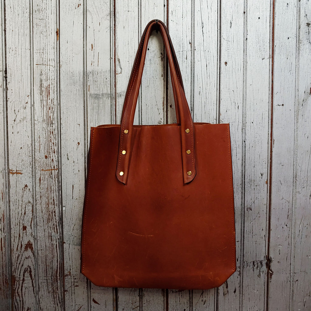 Large Leather Tote in saddle with gold Chicago screws, by Admonish.