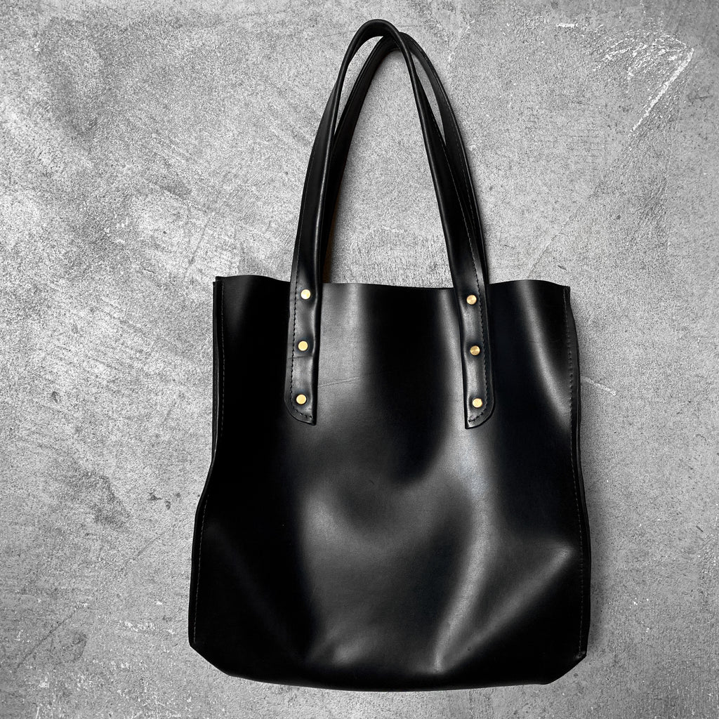 Large Leather Tote in onyx with gold Chicago screws, by Admonish.