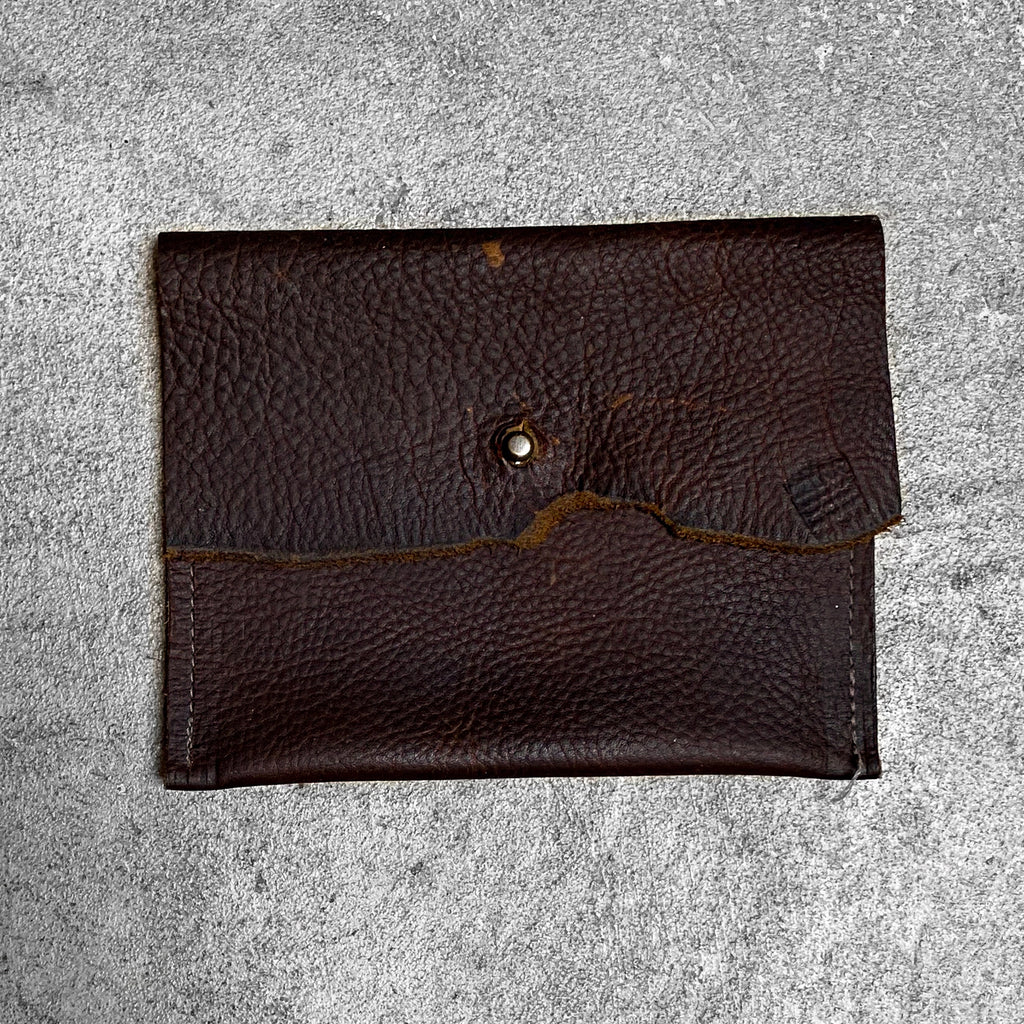 Leather Wallet with Belt Loops and antique brass ball head stud screw. Product color in saddle.