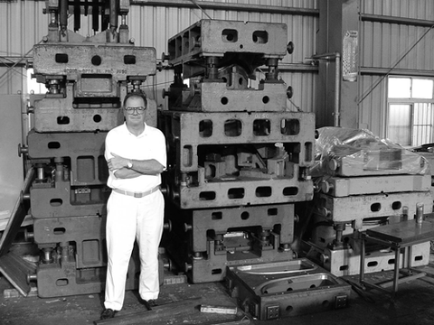 Bob stands with a portion of the tooling for making the 1934 car grille in 2000.