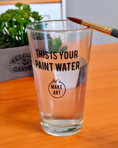 reusable glass filled with water that says this is your paint water