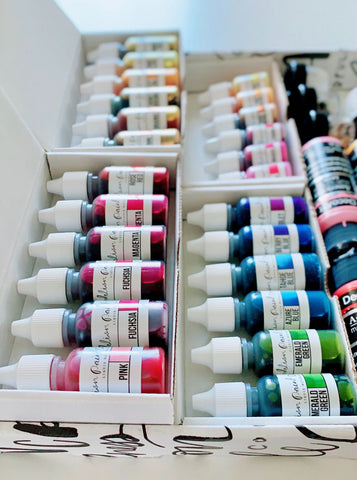 close up of paint bottles in smaller boxes that come inside subscription boxes