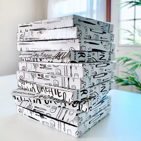 subscription art boxes stacked on top of each other