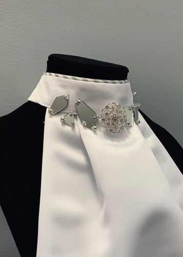 Mirror with broach stock tie