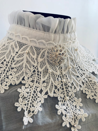 Frilly collar bib with crystals and pearls