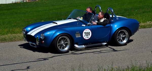 Shelby Cobra racing on a racetrack