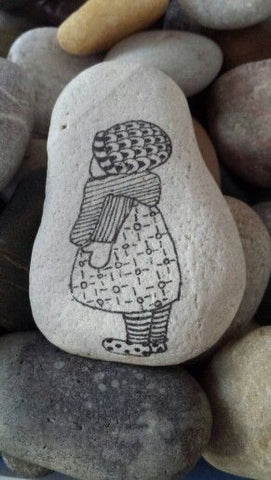 Painted rock little girl ink and pen by artist Ineke Burgman of the Netherlands